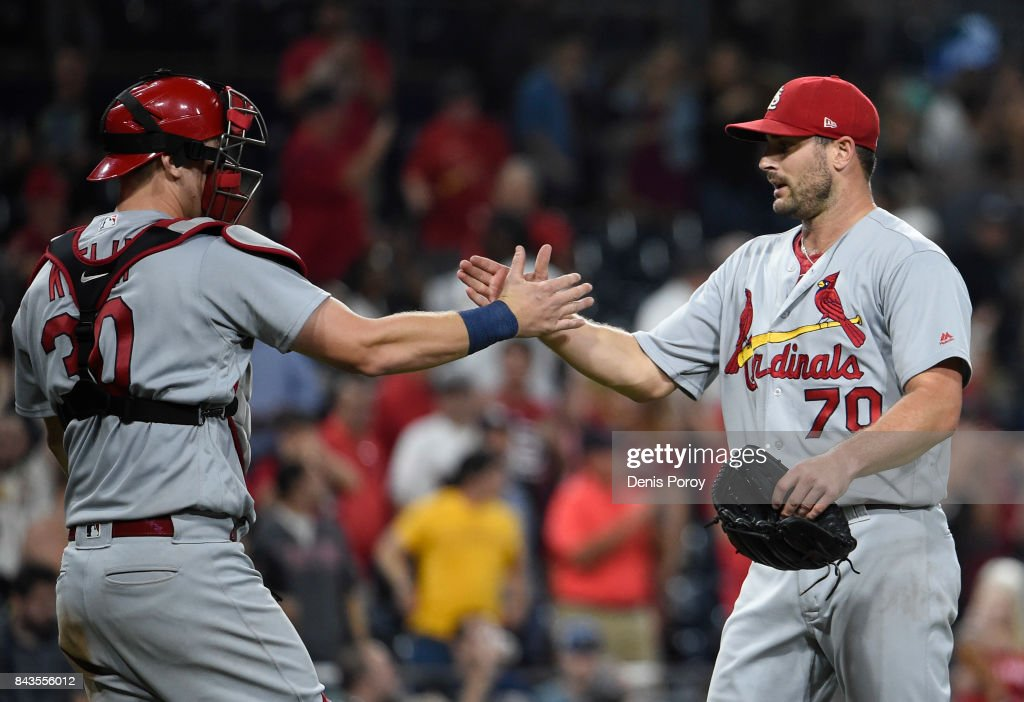 Tyler Lyons #70 of the St. Louis Cardinals, right, is congratulated by Carson Kelly #30 after getting the final out during the ninth inning of a baseball game against the San Diego Padres at PETCO Park on September 6, 2017 in San Diego, California. The Cardinals won 3-1.