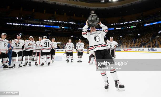 Tyler Madden of the Northeastern Huskies celebrates a 3-2 victory against the Boston College Eagles after NCAA hockey in the Hockey East Championship...