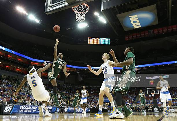 Tyler Madison of the UAB Blazers shoots over Kevon Looney of the UCLA Bruins during the third round of the 2015 NCAA Men's Basketball Tournament at...