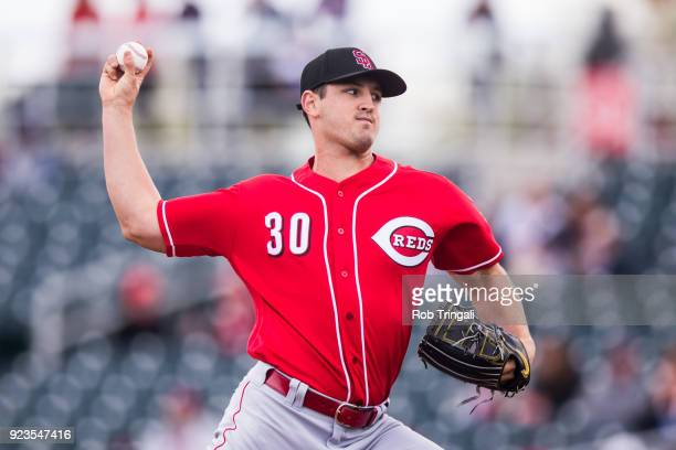 Tyler Mahle of the Cincinnati Reds pitches against the Cleveland Indians during a Spring Training Game at Goodyear Ballpark on February 23 2018 in...