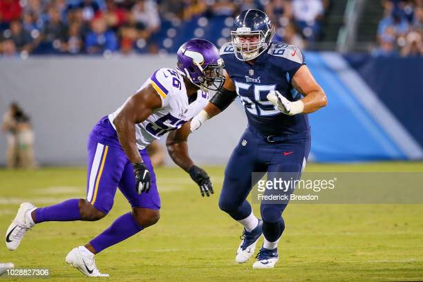 Tyler Marz of the Tennessee Titans plays against Antwione Williams of the Minnesota Vikings during a pre-season game at Nissan Stadium on August 30,...