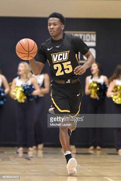 Tyler Maye of the Virginia Commonwealth Rams dribbles up court during a college basketball game against the George Washington Colonials at the Smith...
