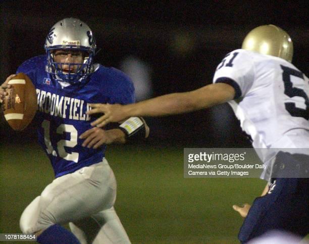 Tyler McBride leftBroomfield High School has pressure put on him by Justin Owens Legacy High School Friday at Elizabeth Kennedy Stadium