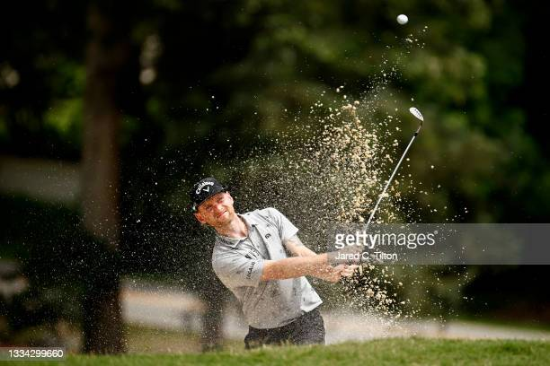 Tyler McCumber of the United States plays a shot from a bunker on the 11th hole during the final round of the Wyndham Championship at Sedgefield...