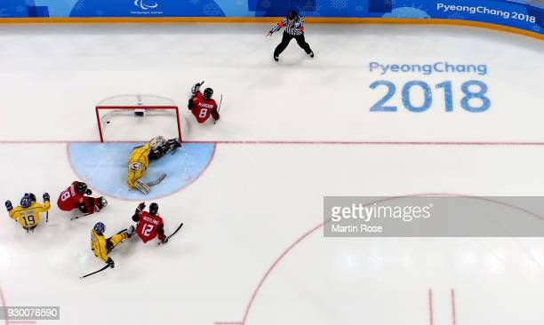 Tyler McGregor of Canada celebrates after scoring a goal over Ulf Nilsson goaltender of Sweden in the Ice Hockey Preliminary Round Group A game...