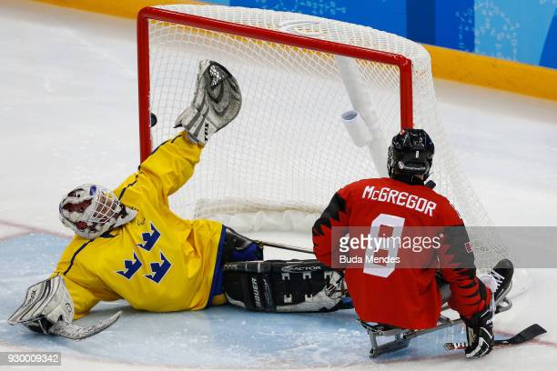 Tyler McGregor of Canada makes a goal against Ulf Nilsson of Sweden in the Ice Hockey Preliminary Round Group A game between Canada and Sweden during...