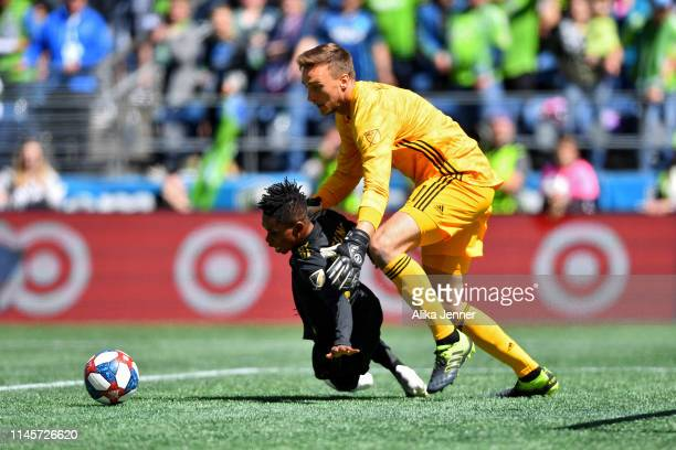 Tyler Miller and Latif Blessing of the Los Angeles FC collide in the goal box during the match against the Seattle Sounders at CenturyLink Field on...