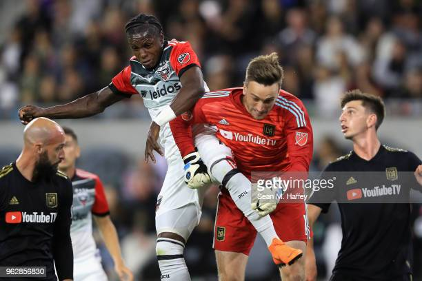 Tyler Miller of Los Angeles FC punches a ball away from Darren Mattocks of DC United on a corner kick during the second half of a game at Banc of...
