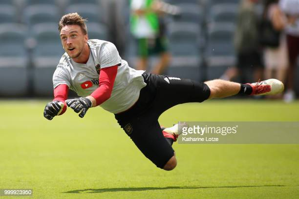 Tyler Miller of the Los Angeles Football Club blocks a shot on goal during a warm up exercise before action against the Portland Timbers at Banc of...
