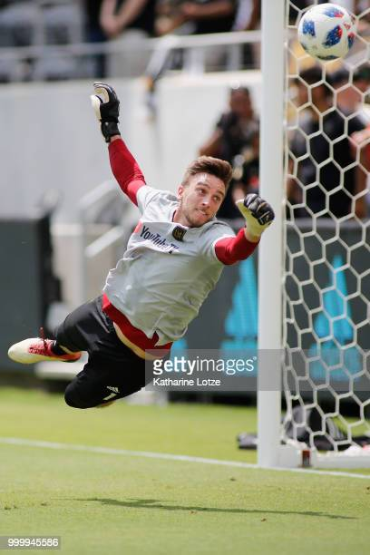Tyler Miller of the Los Angeles Football Club dives to block a shot on goal during a warmup exercise at Banc of California Stadium on July 15 2018 in...