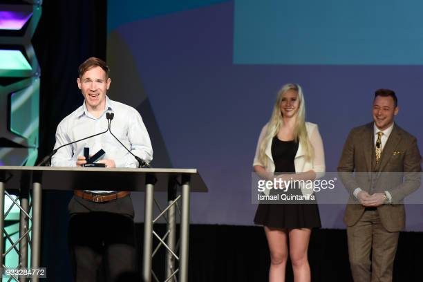 Tyler Moldenhauer poses with the award for Excellence in Animation and Excellence in Art at SXSW Gaming Awards during SXSW at Hilton Austin Downtown...