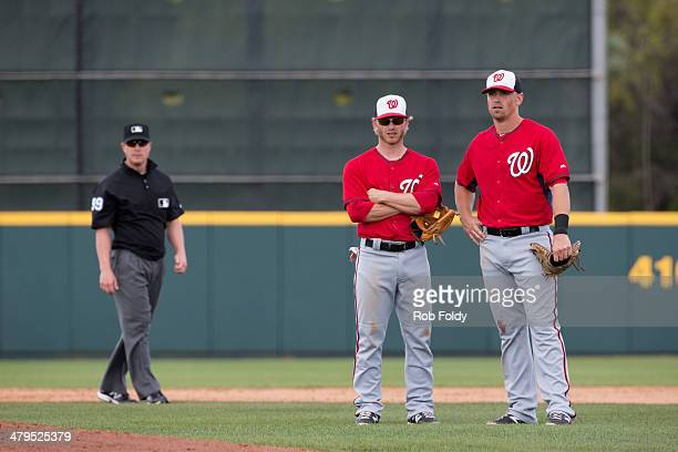 Tyler Moore and Mike Fontenot look on as Jerry Blevins of the Washington Nationals warms up during the spring training game against the Houston...