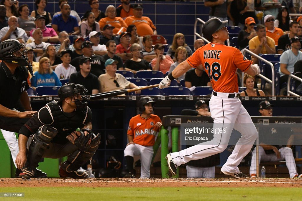 Tyler Moore #28 of the Miami Marlins hits a three-run home run in the third inning against the Arizona Diamondbacks at Marlins Park on June 4, 2017 in Miami, Florida.