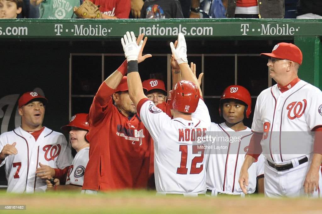 Tyler Moore #12 of the Washington Nationals celebrates hits a solo home run in the seventh inning during game two of a doubleheader baseball game against the Miami Marlins on September 26, 2014 at Nationals Park in Washington, DC. The Marlins won 15-7.