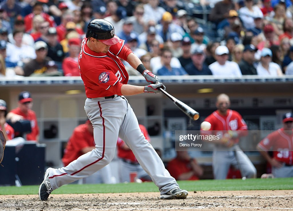 Tyler Moore #12 of the Washington Nationals hits an RBI double during the sixth inning of a baseball game against the San Diego Padres at Petco Park May 17, 2015 in San Diego, California.