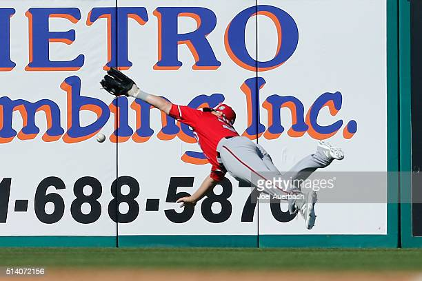 Tyler Moore of the Washington Nationals is unable to catch the ball hit by Randal Grichuk of the St Louis Cardinals for a double in the sixth inning...