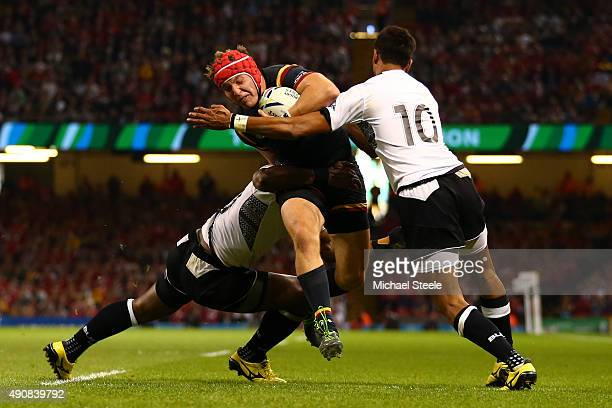 Tyler Morgan of Wales attempts to score a try past Ben Volavola of Fiji during the 2015 Rugby World Cup Pool A match between Wales and Fiji at the...