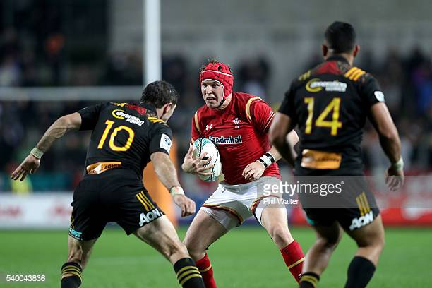 Tyler Morgan of Wales is tackled by Stephen Donald of the Chiefs during the International Test match between the Chiefs and Wales at Waikato Stadium...