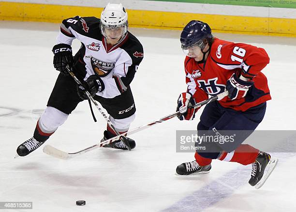 Tyler Morrison of the Vancouver Giants fights for the puck against Reid Duke of the Lethbridge Hurricanes during their WHL game at the Pacific...