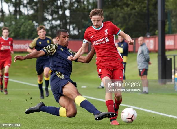 Tyler Morton of Liverpool and David Okagbue of Stoke City in action during the U18 Premier League game at The Kirkby Academy on September 19 2020 in...