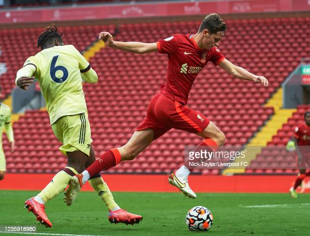 Tyler Morton of Liverpool and Tim Akinola of Arsenal in action during the PL2 game at Anfield on October 17, 2021 in Liverpool, England.