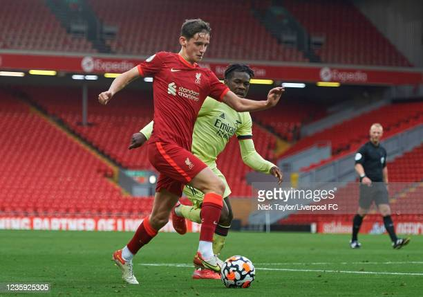 Tyler Morton of Liverpool and Tim Akinola of Arsenal in action during the PL2 game at Anfield on October 16, 2021 in Liverpool, England.