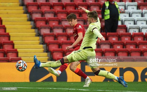 Tyler Morton of Liverpool and Zak Swanson of Arsenal in action during the PL2 game at Anfield on October 16, 2021 in Liverpool, England.