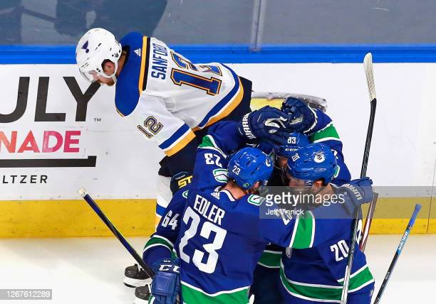 Tyler Motte and the Vancouver Canucks celebrate his goal at 13:19 of the third period against the St. Louis Blues in Game Six of the Western...