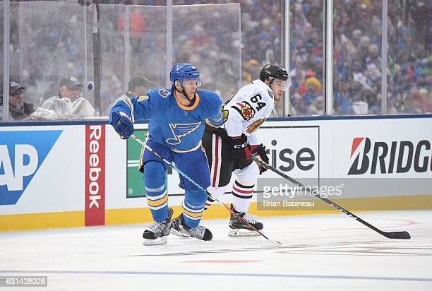Tyler Motte of the Chicago Blackhawks and Carl Gunnarsson of the St Louis Blues skate through the neutral zone during the 2017 Bridgestone NHL Winter...
