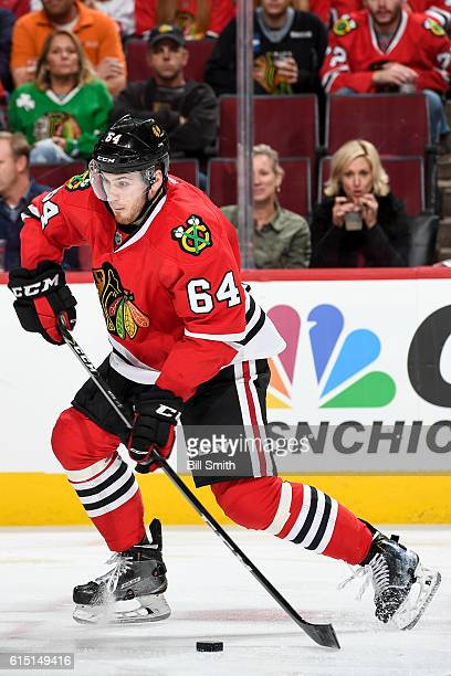 Tyler Motte of the Chicago Blackhawks approaches the puck in the second period against the St Louis Blues during the season opener at the United...