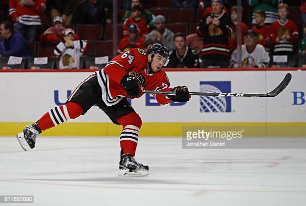 Tyler Motte of the Chicago Blackhawks participates in warmups before a preseason game against the St Louis Blues at the United Center on October 1...