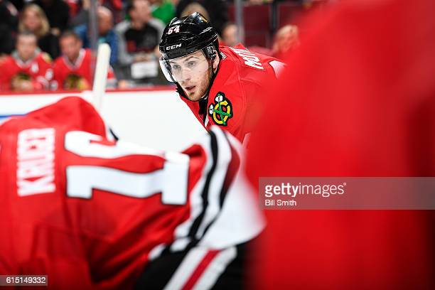 Tyler Motte of the Chicago Blackhawks watches for the puck in the second period against the St Louis Blues during the season opener at the United...
