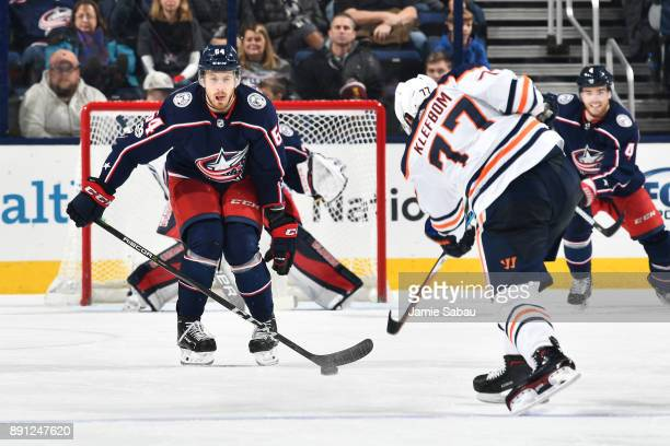 Tyler Motte of the Columbus Blue Jackets attempts to block a shot taken by Oscar Klefbom of the Edmonton Oilers during the third period of a game on...