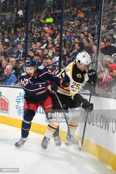 Tyler Motte of the Columbus Blue Jackets collides with Brandon Carlo of the Boston Bruins during the third period of a game on October 30 2017 at...