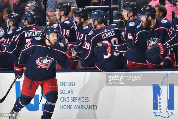 Tyler Motte of the Columbus Blue Jackets highfives his teammates after scoring a goal during the second period of a game against the Boston Bruins on...