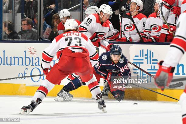Tyler Motte of the Columbus Blue Jackets is knocked to the ice by Victor Rask of the Carolina Hurricanes during the second period of a game on...