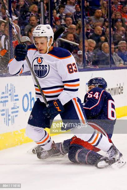 Tyler Motte of the Columbus Blue Jackets looses his skates while chasing after the puck with Matthew Benning of the Edmonton Oilers on December 12...