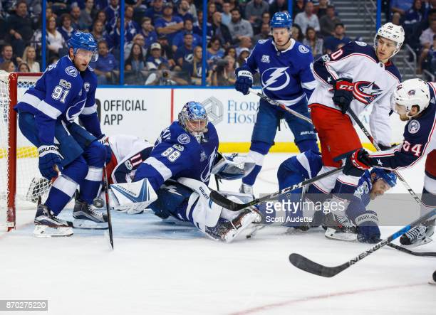 Tyler Motte of the Columbus Blue Jackets shoots the puck against Steven Stamkos and goalie Andrei Vasilevskiy of the Tampa Bay Lightning during the...