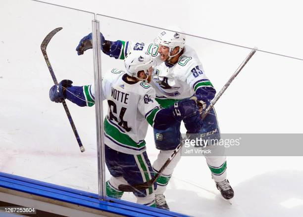 Tyler Motte of the Vancouver Canucks celebrates his goal at 18:17 of the second period against the St. Louis Blues and is joined by Jay Beagle in...