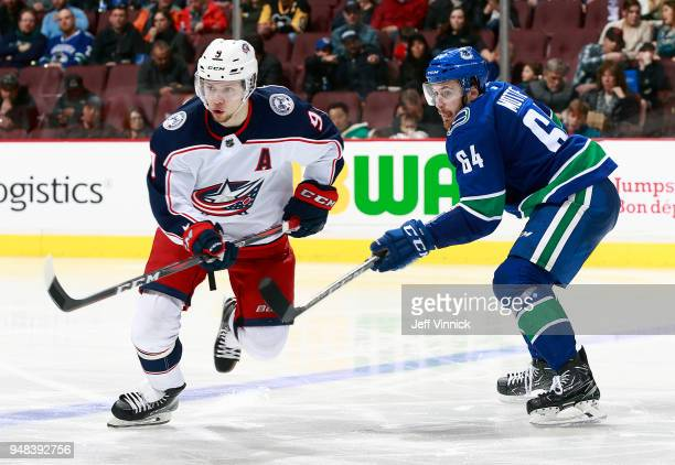 Tyler Motte of the Vancouver Canucks checks Artemi Panarin of the Columbus Blue Jackets during their NHL game at Rogers Arena March 31 2018 in...