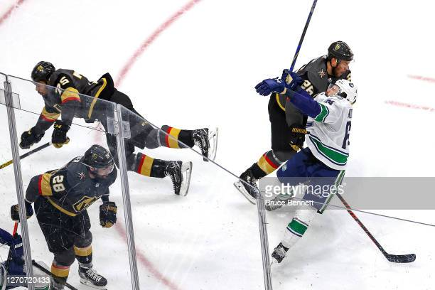 Tyler Motte of the Vancouver Canucks is hit and injured by Ryan Reaves of the Vegas Golden Knights during the second period in Game Seven of the...