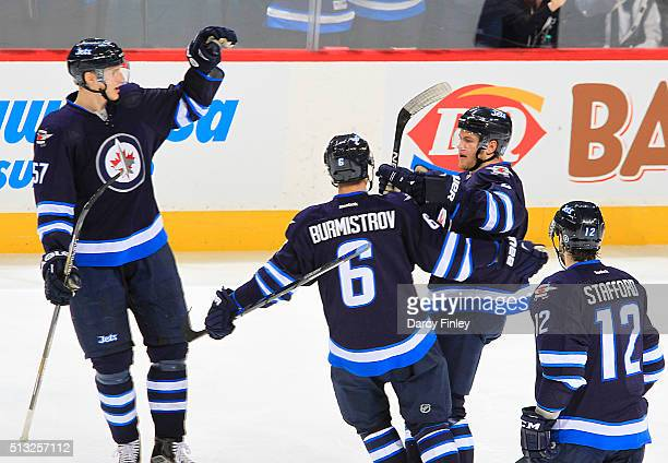 Tyler Myers Alexander Burmistrov Andrew Copp and Drew Stafford of the Winnipeg Jets celebrate a second period goal against the Florida Panthers at...
