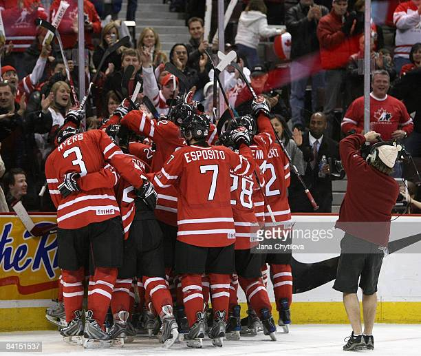 Tyler Myers and Angelo Esposito of Team Canada and teammates celebrate their win over Team USA during the IIHF World Junior Championships held at...