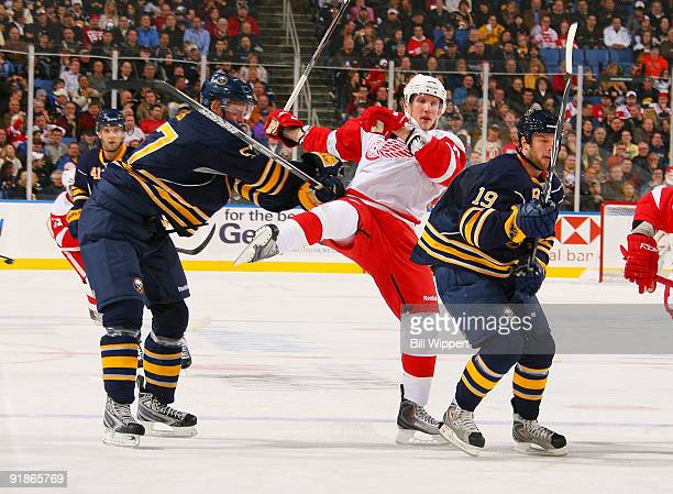 Tyler Myers and Tim Connolly of the Buffalo Sabres defend against Justin Abdelkader of the Detroit Red Wings during the second period on October 13...