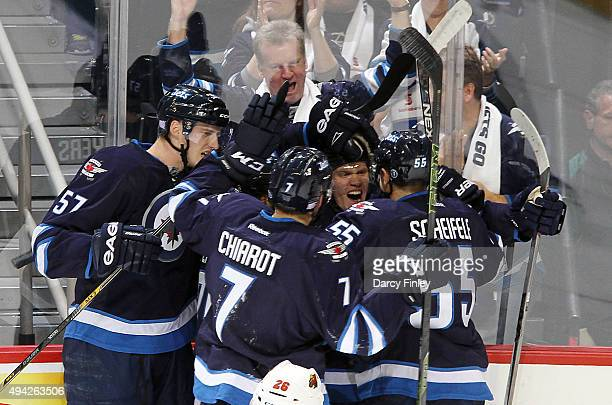 Tyler Myers Ben Chairot Nikolaj Ehlers and Mark Scheifele of the Winnipeg Jets celebrate a first period goal against the Minnesota Wild at the MTS...