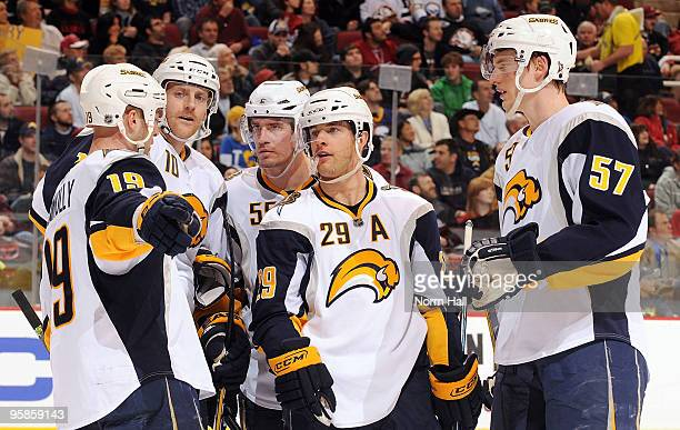Tyler Myers Jason Pominville and Tim Connolly of the Buffalo Sabres talk things over during a break in play against the Phoenix Coyotes on January 18...