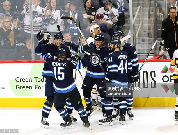 Tyler Myers Matt Hendricks Brendan Lemieux Josh Morrissey and Joel Armia of the Winnipeg Jets celebrate a third period goal against the Pittsburgh...