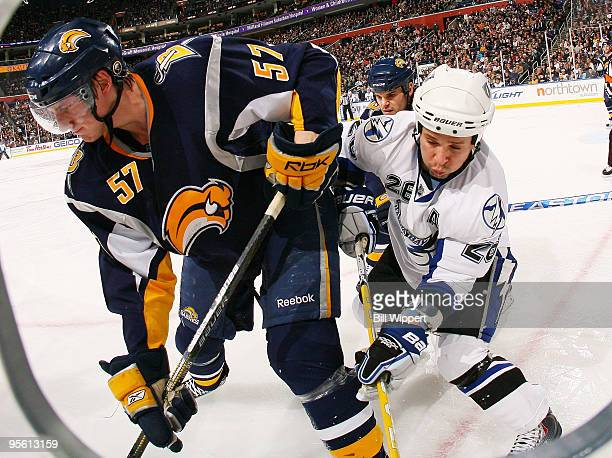 Tyler Myers of the Buffalo Sabres battles for the puck along the boards with Martin St Louis of the Tampa Bay Lightning on January 6, 2010 at HSBC...