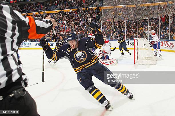 Tyler Myers of the Buffalo Sabres celebrates after scoring the game winning overtime goal against Peter Budaj of the Montreal Canadiens at First...