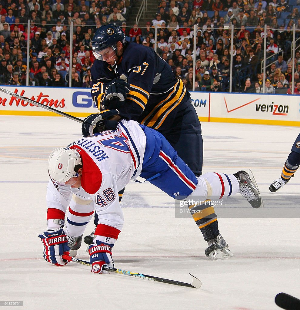 6c9115afe Tyler Myers  57 of the Buffalo Sabres checks Andrei Kostitsyn  46 of the  Montreal